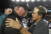 Andy Reid, coach of the Philadelphia Eagles, talks with Bill Belichick, coach of the New England Patriots,  after a preseason game at Gillette Stadium on August  20, 2012 in Foxboro, Massachusetts.