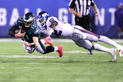 Carson Wentz #11 of the Philadelphia Eagles dives for yardage against Alec Ogletree #52 of the New York Giants during the third quarter at MetLife Stadium on October 11, 2018 in East Rutherford, New Jersey.