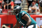 Ryan Fitzpatrick #14 of the Tampa Bay Buccaneers is sacked by Fletcher Cox #91 of the Philadelphia Eagles during a game  at Raymond James Stadium on September 16, 2018 in Tampa, Florida.