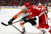 Andrew MacDonald #47 of the Philadelphia Flyers battles against the Frans Nielsen #51 of the Detroit Red Wings at Little Caesars Arena on January 23, 2018 in Detroit, Michigan.