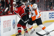 Jacob Josefson #16 of the New Jersey Devils is hit into the boards by Pierre-Edouard Bellemare #78 of the Philadelphia Flyers during the first period at the Prudential Center on October 2, 2015 in Newark, New Jersey.