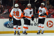 (L-R) Claude Giroux #28, Scott Hartnell #19 and Wayne Simmonds #17 of the Philadelphia Flyers celebrate Hartnell's powerplay goal at 11:50 of the first period against the New Jersey Devils in Game Four of the Eastern Conference Semifinals during the 2012 NHL Stanley Cup Playoffs at Prudential Center on May 6, 2012 in Newark, New Jersey.
