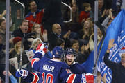 Jesper Fast #19 of the New York Rangers celebrates his first goal in the NHL with J.T. Miller #10, and Kevin Klein #8 against the Philadelphia Flyers during their game at Madison Square Garden on November 29, 2014 in New York City.