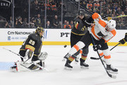 Marc-Andre Fleury #29 of the Vegas Golden Knights blocks a shot as Sean Couturier #14 of the Philadelphia Flyers looks for a rebound against William Karlsson #71 of the Golden Knights in the first period of their game at T-Mobile Arena on October 04, 2018 in Las Vegas, Nevada. The Flyers defeated the Golden Knights 5-2.