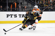 Max Pacioretty #67 of the Vegas Golden Knights skates with the puck under pressure from Andrew MacDonald #47 of the Philadelphia Flyers in the second period of their game at T-Mobile Arena on October 04, 2018 in Las Vegas, Nevada. The Flyers defeated the Golden Knights 5-2.