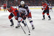 Brandon Dubinsky #17 of the Columbus Blue Jackets skates past John Carlson #74 of the Washington Capitals during the first period at Capital One Arena on February 9, 2018 in Washington, DC.