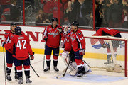 Nicklas Backstrom #19 and Brooks Orpik #44 celebrate with goalie Braden Holtby #70 of the Washington Capitals after defeating the Philadelphia Flyers 1-0 at Verizon Center on January 14, 2015 in Washington, DC.