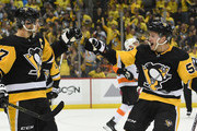 Sidney Crosby #87 of the Pittsburgh Penguins celebrates with Jake Guentzel #59 after scoring a goal during the second period in Game One of the Eastern Conference First Round during the 2018 NHL Stanley Cup Playoffs against the Philadelphia Flyers at PPG PAINTS Arena on April 11, 2018 in Pittsburgh, Pennsylvania.