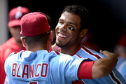 Nick Williams #5 of the Philadelphia Phillies celebrates with Andres Blanco #4 after hitting a grand slam in the sixth inning against the Milwaukee Brewers at Miller Park on July 16, 2017 in Milwaukee, Wisconsin.