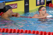 Ryan Murphy and Matt Grevers react after their swims in the Men 100 LC Meter Backstroke Final during day 4 of the Phillips 66 National Swimming Championships at the Woollett Aquatics Center on July 28, 2018 in Irvine, California.