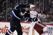 James Wright #17 of the Winnipeg Jets collides with Michael Stone #26 of the Phoenix Coyotes in second period action in an NHL game at the MTS Centre on January 13, 2014 in Winnipeg, Manitoba, Canada.