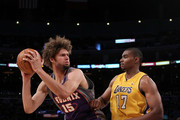 Robin Lopez #15 of the Phoenix Suns looks to move the ball as Andrew Bynum #17 of the Los Angeles Lakers defends in the second quarter of Game Five of the Western Conference Finals during the 2010 NBA Playoffs at Staples Center on May 27, 2010 in Los Angeles, California. NOTE TO USER: User expressly acknowledges and agrees that, by downloading and/or using this Photograph, user is consenting to the terms and conditions of the Getty Images License Agreement.