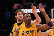 Kobe Bryant #24 and Pau Gasol #16 of the Los Angeles Lakers celebrate a Bryant basket against the Phoenix Suns at Staples Center on January 10, 2012 in Los Angeles, California. The Lakers won 99-83. NOTE TO USER: User expressly acknowledges and agrees that, by downloading and or using this photograph, User is consenting to the terms and conditions of the Getty Images License Agreement.