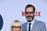"""Patricia Arquette (L) and Eric White arrive at the photo call for Netflix's """"Otherhood"""" at the Egyptian Theatre on July 31, 2019 in Hollywood, California."""