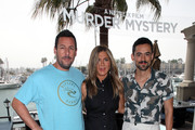 "(L-R) Adam Sandler, Jennifer Aniston and Luis Gerardo Mendez attend a photocall of Netflix's ""Murder Mystery"" at the Ritz Carlton Marina Del Rey on June 11, 2019 in Marina del Rey, California."
