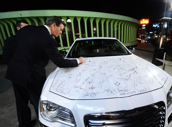 Pierce Brosnan Actor Pierce Brosnan signs the Chrysler 300 at Vanity Fair Campaign Hollywood 2011 with Chrysler celebrating Artists for Peace and Justice presented by Brioni held at Eveleigh on February 22, 2011 in West Hollywood, California.