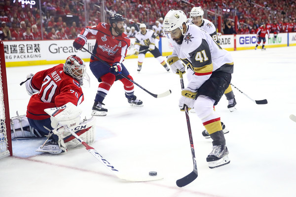 2018 NHL Stanley Cup Final - Game Three [player,college ice hockey,ice hockey,ice hockey position,sports,hockey,sports gear,hockey protective equipment,team sport,ball game,pierre-edouard bellemare,braden holtby,three,game,net,capital one arena,nhl,washington capitals,vegas golden knights,stanley cup final]