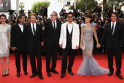 """(L-R) Actors Astrid Berges-Frisbey, Ian McShane, producer Jerry Bruckheimer, Geoffrey Rush, Johnny Depp, Penelope Cruz, and director Rob Marshall attend the """"Pirates of the Caribbean: On Stranger Tides"""" premiere at the Palais des Festivals during the 64th Cannes Film Festival on May 14, 2011 in Cannes, France."""