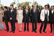 """(L-R) Actors Penelope Cruz, director Rob Marshall, Sam Claflin, Astrid Berges-Frisbey, producer Jerry Bruckheimer, Geoffrey Rush, Johnny Depp, and Ian McShane attend the """"Pirates of the Caribbean: On Stranger Tides"""" premiere at the Palais des Festivals during the 64th Cannes Film Festival on May 14, 2011 in Cannes, France."""