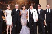 """(L-R) Actors Sam Claflin, Astrid Berges-Frisbey, Geoffrey Rush,  Penelope Cruz, Johnny Depp, director Rob Marshall,  producer Jerry Bruckheimer and Ian McShane depart the """"Pirates of the Caribbean: On Stranger Tides"""" premiere at the Palais des Festivals during the 64th Cannes Film Festival on May 14, 2011 in Cannes, France."""