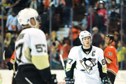 Sidney Crosby #87 of the Pittsburgh Penguins and David Perron #57 leave the ice after a 2-1 loss to the Anaheim Ducks at Honda Center on December 6, 2015 in Anaheim, California.