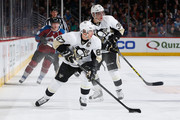 Sidney Crosby #87 of the Pittsburgh Penguins controls the puck against the Colorado Avalanche as David Perron #39 of the Pittsburgh Penguins follows the play at Pepsi Center on March 4, 2015 in Denver, Colorado.