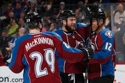 Jarome Iginla #12 of the Colorado Avalanche celebrates his goal against the Pittsburgh Penguins with Ryan O'Reilly #90 and Nathan MacKinnon #29 of the Colorado Avalanche at Pepsi Center on March 4, 2015 in Denver, Colorado. The Avalanche defeated the Penguins 3-1.
