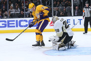Goalie Marc-Andre Fleury #29 of the Pittsburgh Penguins makes a save in front of Tyler Toffoli #73 of the Los Angeles Kings at Staples Center on March 7, 2015 in Los Angeles, California.