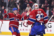Max Domi #13 of the Montreal Canadiens reacts with goaltender Antti Niemi #37 after defeating the Pittsburgh Penguins 4-3 in a shootout during the NHL game at the Bell Centre on October 13, 2018 in Montreal, Quebec, Canada.