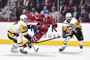 Jonathan Drouin #92 of the Montreal Canadiens tries to skate past Sidney Crosby #87 and Kris Letang #58 of the Pittsburgh Penguins during the NHL game at the Bell Centre on October 13, 2018 in Montreal, Quebec, Canada.  The Montreal Canadiens defeated the Pittsburgh Penguins 4-3 in a shootout.