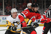 Patric Hornqvist #72 of the Pittsburgh Penguins gets tangle dup with Kenny Agostino #17 of the New Jersey Devils during the first period at the Prudential Center on February 19, 2019 in Newark, New Jersey.