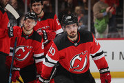 Marcus Johansson #90 of the New Jersey Devils returns to the bench after scoring a first period goal against the Pittsburgh Penguins at the Prudential Center on February 19, 2019 in Newark, New Jersey.