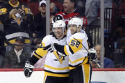 Sidney Crosby #87 of the Pittsburgh Penguins celebrates his game winning goal in overtime and is joined by Kris Letang #58 against the New Jersey Devils at the Prudential Center on March 29, 2018 in Newark, New Jersey.  The Penguins defeated the Devils 4-3 in overtime.