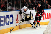 Kris Letang #38 of the Pittsburgh Penguins controls the puck from Marc Staal #18 of of the New York Rangers at Madison Square Garden on February 13, 2011 in New York City. The Rangers defeated the Penguins 5-3.