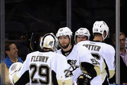 Marc-Andre Fleury #29 of the Pittsburgh Penguins celebrates with teammate Kris Letang #58 after defeating the New York Rangers 4-2 during Game Four of the Second Round in the 2014 NHL Stanley Cup Playoffs at Madison Square Garden on May 7, 2014 in New York City.