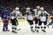 Chris Kunitz #14 of the Pittsburgh Penguins (2nd from left) celebrates his power play goal at 9:41 of the third period against the New York Rangers in Game One of the Eastern Conference Quarterfinals during the 2015 NHL Stanley Cup Playoffs at Madison Square Garden on April 18, 2015 in New York City. Joining Kunitz is David Perron #39 (l), Brandon Sutter #16 and Taylor Chorney #44. The Penguins defeated the Rangers 4-3.