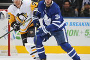 Patric Hornqvist #72 of the Pittsburgh Penguins skates against Auston Matthews #34 of the Toronto Maple Leafs during an NHL game at Scotiabank Arena on October 18, 2018 in Toronto, Ontario, Canada. The Penguins defeated the Maple Leafs 3-0.