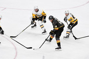 James Neal #18 of the Vegas Golden Knights skates with the puck against (L-R) Kris Letang #58, Brian Dumoulin #8, Dominik Simon #49 and Sidney Crosby #87 of the Pittsburgh Penguins in the first period of their game at T-Mobile Arena on December 14, 2017 in Las Vegas, Nevada. The Golden Knights won 2-1.