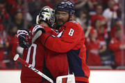 Braden Holtby #70 of the Washington Capitals and Alex Ovechkin #8 of the Washington Capitals celebrate after defeating the Pittsburgh Penguins in Game Five of the Eastern Conference Second Round during the 2018 NHL Stanley Cup Playoffs at Capital One Arena on May 5, 2018 in Washington, DC.
