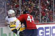 Brooks Orpik #44 of the Washington Capitals checks Patric Hornqvist #72 of the Pittsburgh Penguins during the first period in Game One of the Eastern Conference Second Round during the 2018 NHL Stanley Cup Playoffs at the Capital One Arena on April 26, 2018 in Washington, DC.