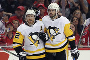 Patric Hornqvist #72 of the Pittsburgh Penguins (l) celebrates his goal at 2:59 of the third period against the Washington Capitals and is joined by Justin Schultz #4 (r) in Game One of the Eastern Conference Second Round during the 2018 NHL Stanley Cup Playoffs at the Capital One Arena on April 26, 2018 in Washington, DC. The Penguins defeated the Capitals 3-2.