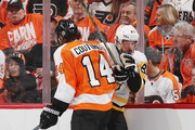 Sean Couturier #14 of the Philadelphia Flyers steps into Sidney Crosby #87 of the Pittsburgh Penguins during the first period in Game Three of the Eastern Conference First Round during the 2018 NHL Stanley Cup Playoffs at the Wells Fargo Center on April 15, 2018 in Philadelphia, Pennsylvania.