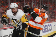 Brian Dumoulin #8 of the Pittsburgh Penguins is checked by Claude Giroux #28 of the Philadelphia Flyers in Game Six of the Eastern Conference First Round during the 2018 NHL Stanley Cup Playoffs at the Wells Fargo Center on April 22, 2018 in Philadelphia, Pennsylvania. The Penguins defeated the Flyers 8-5.