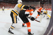 Claude Giroux #28 of the Philadelphia Flyers gets the high stick from Olli Maatta #3 of the Pittsburgh Penguins during the second period in Game Three of the Eastern Conference First Round during the 2018 NHL Stanley Cup Playoffs at the Wells Fargo Center on April 15, 2018 in Philadelphia, Pennsylvania.