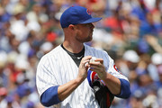Starting pitcher Jon Lester #34 of the Chicago Cubs tries to collect himself after giving up a grand slam home run in the 1st inning  against Pittsburgh Pirates at Wrigley Field on July 9, 2017 in Chicago, Illinois.