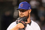 Starting pitcher Jon Lester #34 of the Chicago Cubs looks for the signs against the Pittsburgh Pirates at Wrigley Field on September 27, 2018 in Chicago, Illinois.