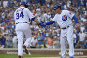 Brian Butterfield #55 of the Chicago Cubs congratulates Jon Lester #34 of the Chicago Cubs for his solo home run in the third inning against the Pittsburgh Pirates at Wrigley Field on July 13, 2019 in Chicago, Illinois.