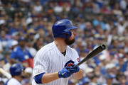 Starting pitcher Jon Lester #34 of the Chicago Cubs hits a two run single in the first inning against the Pittsburgh Pirates at Wrigley Field on July 13, 2019 in Chicago, Illinois.