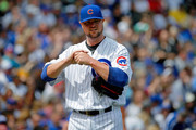 Jon Lester #34 of the Chicago Cubs reacts after walking Jordy Mercer #10 of the Pittsburgh Pirates (not pictured) during the first inning at Wrigley Field on April 16, 2017 in Chicago, Illinois.