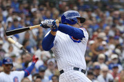 Anthony Rizzo #44 of the Chicago Cubs hits a RBI single in the first inning against the Pittsburgh Pirates at Wrigley Field on July 13, 2019 in Chicago, Illinois.